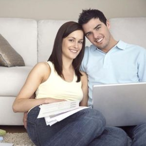 A couple receiving an online insurance quote in Halifax