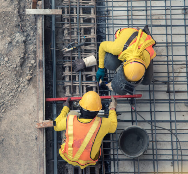 Construction workers working with rebar